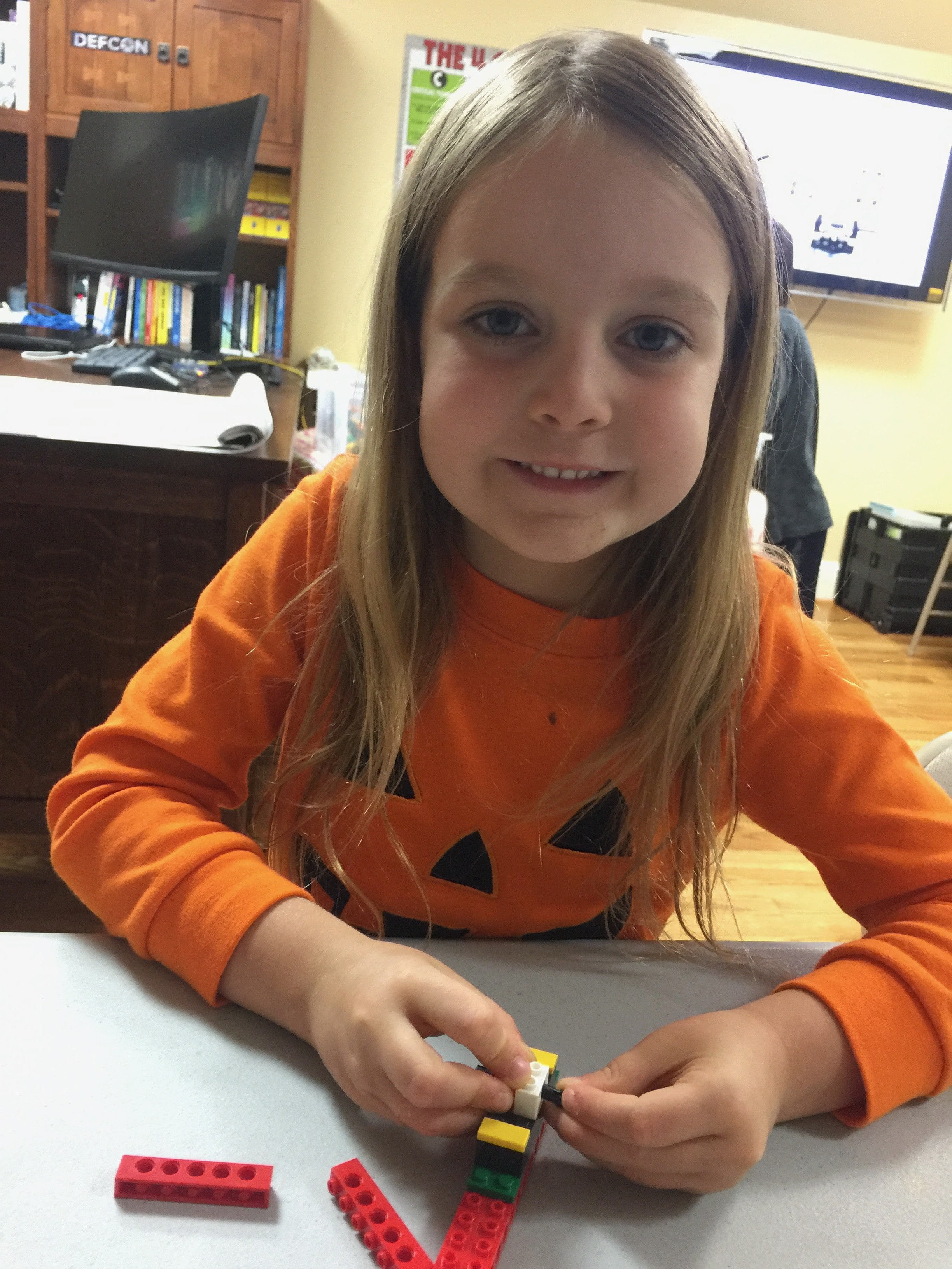 Girl with Lego Robotics project